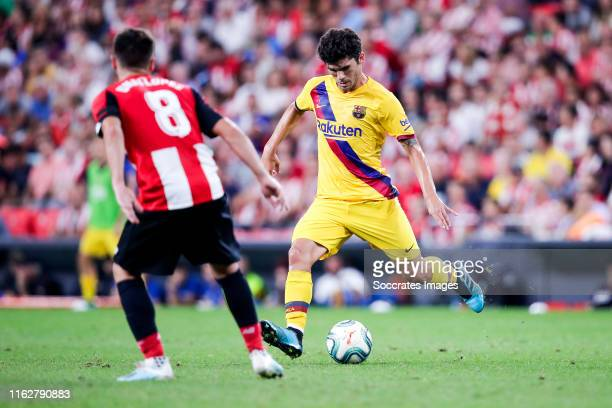 Unai Lopez of Athletic Bilbao Carles Alena of FC Barcelona during the La Liga Santander match between Athletic de Bilbao v FC Barcelona at the...