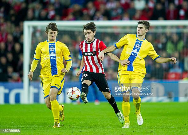 Unai Lopez of Athletic Club duels for the ball with Dmitri Baga and Aleksandr Karnitski of FC BATE Borisov during the UEFA Champions League Group H...