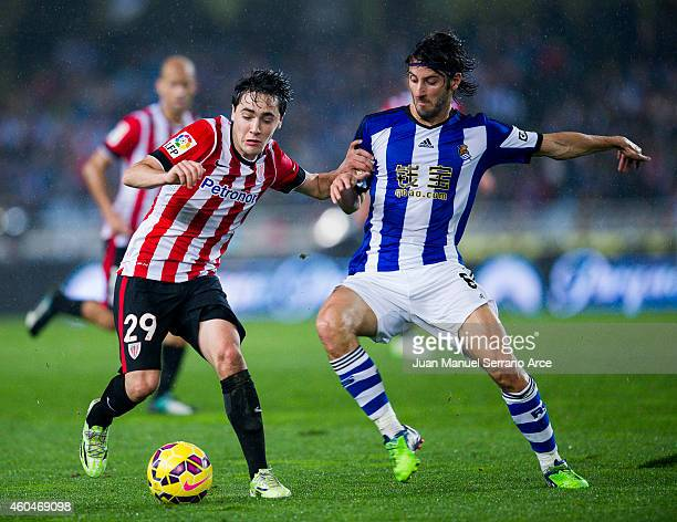 Unai Lopez of Athletic Club duels for the ball with Esteban Granero of Real Sociedad during the La Liga match between Real Sociedad and Athletic Club...