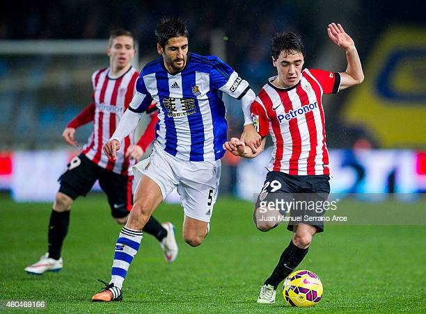 Unai Lopez of Athletic Club duels for the ball with Markel Bergara of Real Sociedad during the La Liga match between Real Sociedad and Athletic Club...