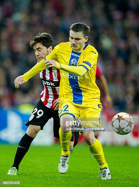 Unai Lopez of Athletic Club duels for the ball with Mikhail Gordeychuk of FC BATE Borisov during the UEFA Champions League Group H match between...