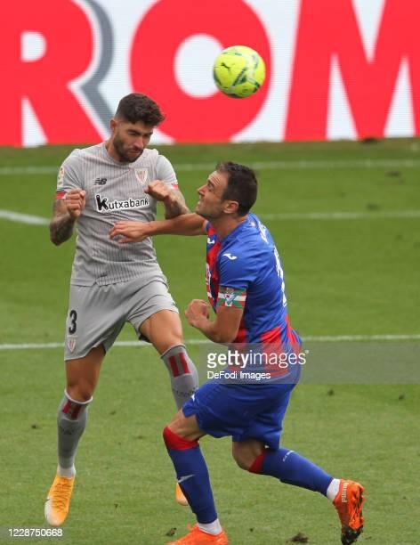 Unai Nunez of Athletic Bilbao and Kike Garcia of SD Eibar battle for the ball during the LaLiga Santander match between Eibar and Athletic Club on...