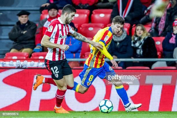 Unai Nunez of Athletic Bilbao Luciano Vietto of Valencia CF during the La Liga Santander match between Athletic de Bilbao v Valencia at the Estadio...