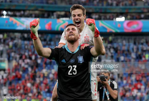 Unai Simon and Cesar Azpilicueta of Spain celebrate following their team's victory in the penalty shoot out after the UEFA Euro 2020 Championship...