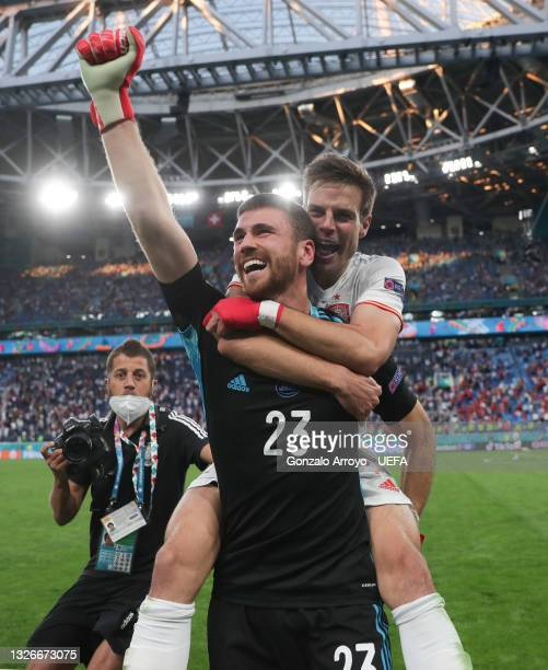 Unai Simon and Cesar Azpilicueta of Spain celebrate their side's victory in the penalty shoot out after the UEFA Euro 2020 Championship Quarter-final...