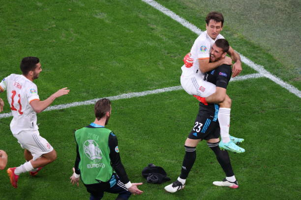 Unai Simon and Mikel Oyarzabal of Spain celebrating during the European championship EURO 2020 between Switzerland and Spain at Gazprom Arena. .