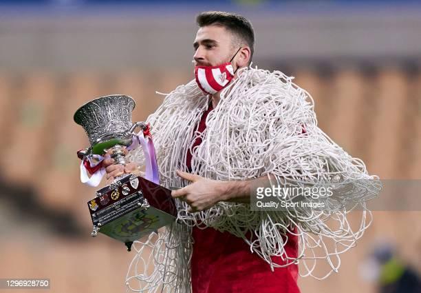 Unai Simon of Athletic Club celebrates with the Supercopa de Espana Trophy following his team's victory in the Supercopa de Espana Final match...