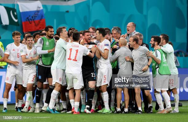Unai Simon of Spain celebrates with teammates after winning in a penalty shoot out during the UEFA Euro 2020 Championship Quarter-final match between...