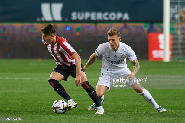 Unai Vencedor of Athletic and Toni Kroos of Real Madrid compete for the ball during the Supercopa de Espana Semi Final match between Real Madrid and...