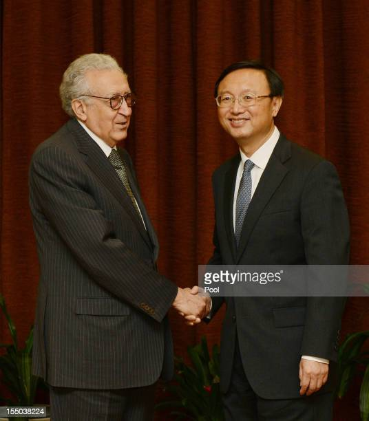 Arab League peace envoy for Syria Lakhdar Brahimi shakes hands with Chinese Foreign Minister Yang Jiechi prior to their meeting at the Ministry of...