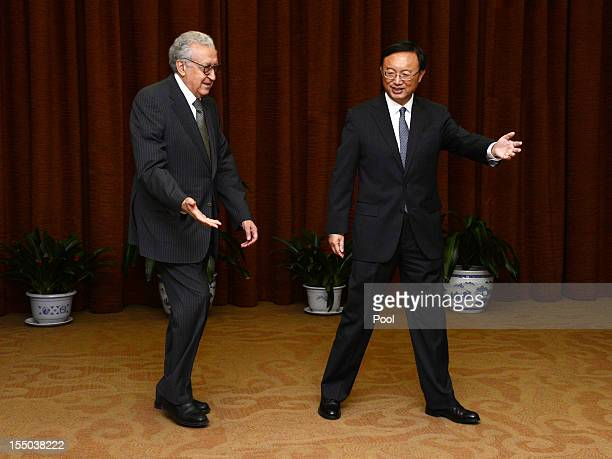 Arab League peace envoy for Syria Lakhdar Brahimi walks with Chinese Foreign Minister Yang Jiechi prior to their meeting at the Ministry of Foreign...