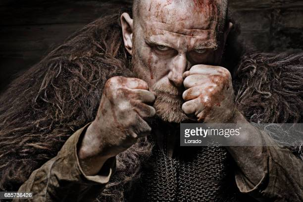unarmed bloody viking warrior in emotional pose - barbarian stock photos and pictures