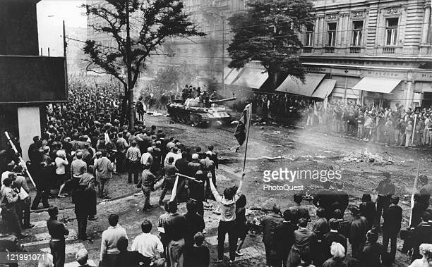 Unarmed citizens jeer invading Soviet military forces shouting Fascists and Russians go home Prague Czechoslovakia August 1968