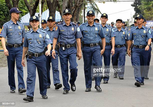 Unarmed policemen patrol the premises of the national Camp Crame headquarters in suburban Manila on January 5 2010 where the prime suspect in the...