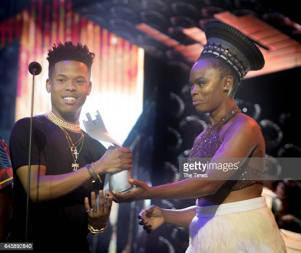 Unathi Msengana hands over the Song of the year award to Nasty C during the 16th annual Metro FM Music Awards held at the Inkosi Luthuli Convention...