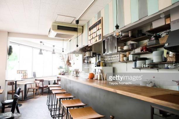 unattended restaurant with bright lights - restaurant stock pictures, royalty-free photos & images