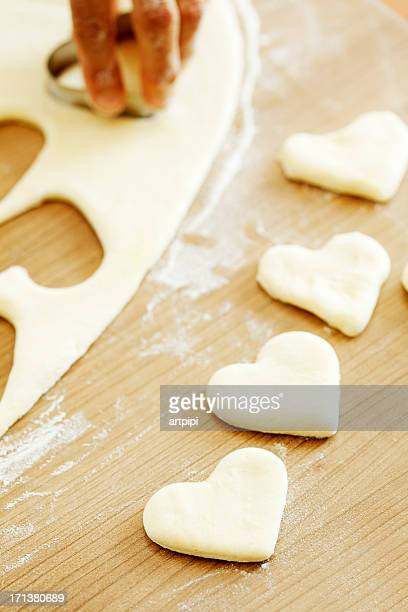 unbaked heart shape cookies - heart month stock photos and pictures