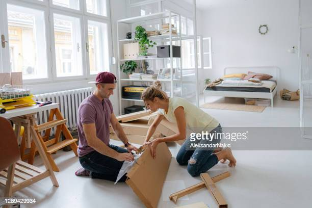 unboxing a new furniture - unboxing stock pictures, royalty-free photos & images
