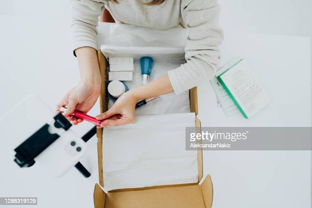 unboxing subscription boxes - unboxing stock pictures, royalty-free photos & images