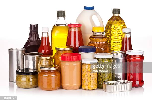 un-branded canned goods, conserves, sauces and oils - tin can stock pictures, royalty-free photos & images