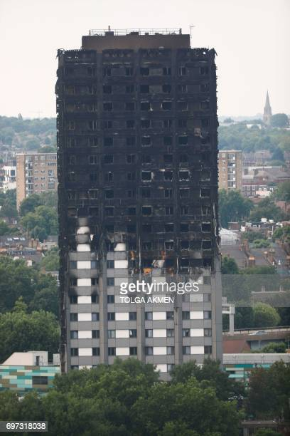 Unburned lower floors with untouched cladding in place are seen with the burnt out upper floors of the Grenfell Tower block in North Kensington west...