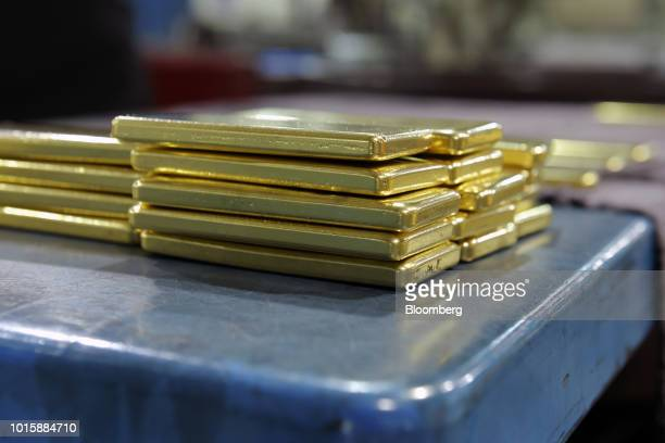 Unburnished one kilogram gold bars sit stacked at the Perth Mint Refinery operated by Gold Corp in Perth Australia on Thursday Aug 9 2018 Demand for...