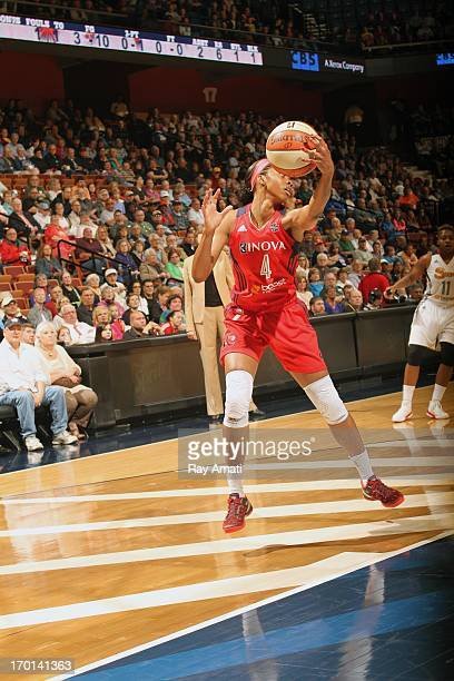 Tayler Hill of the Washington Mystics grabs a rebound against the Connecticut Sun during the game on June 7 2013 at the Mohegan Sun Arena Uncasville...