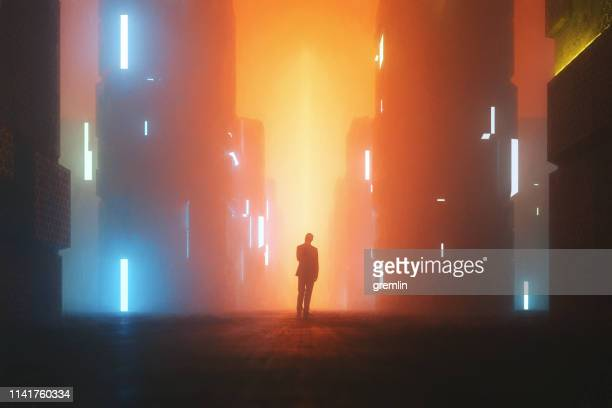 uncertain businessman standing on the street at night - futuristic stock pictures, royalty-free photos & images