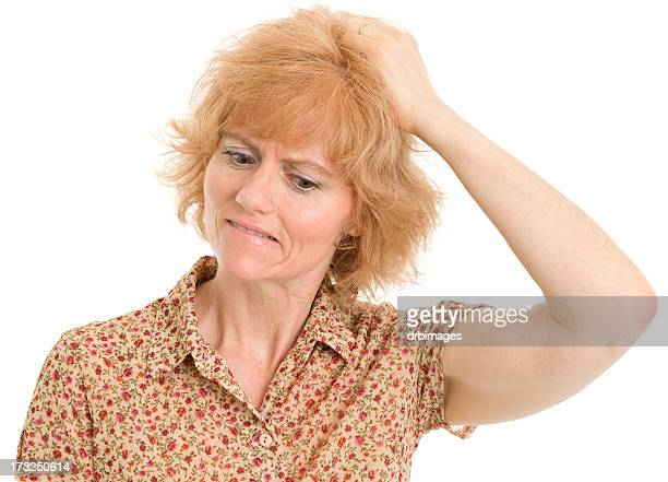 Uncertain Mature Woman Scratches Head
