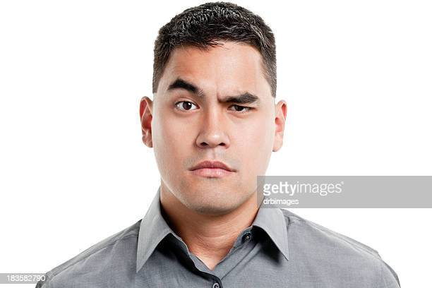 uncertain young man raises one eyebrow - curiosity stock pictures, royalty-free photos & images