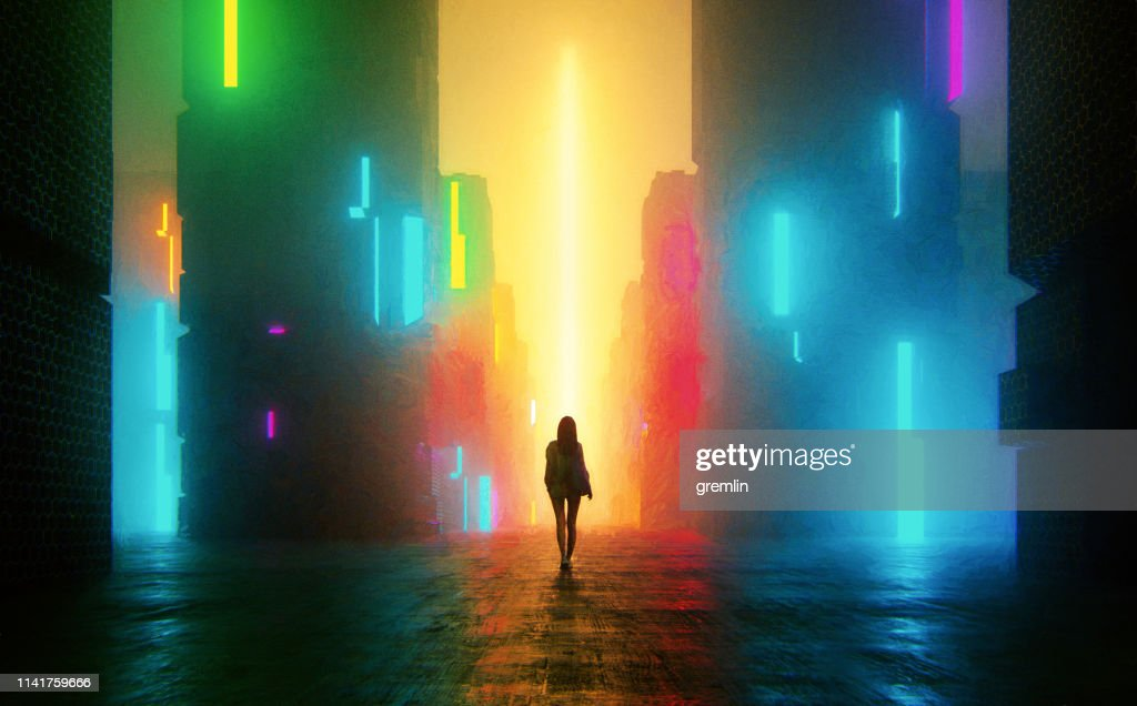 Uncertain young woman standing on the street at night : Stock Photo