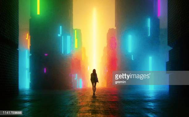 uncertain young woman standing on the street at night - futuristic stock pictures, royalty-free photos & images