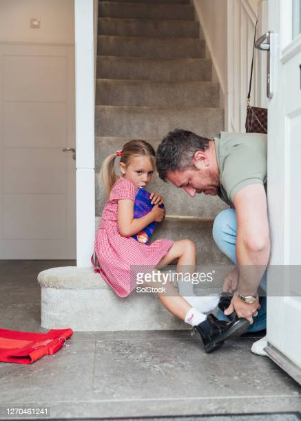 uncertainty about returning to school - school girl shoes stock pictures, royalty-free photos & images