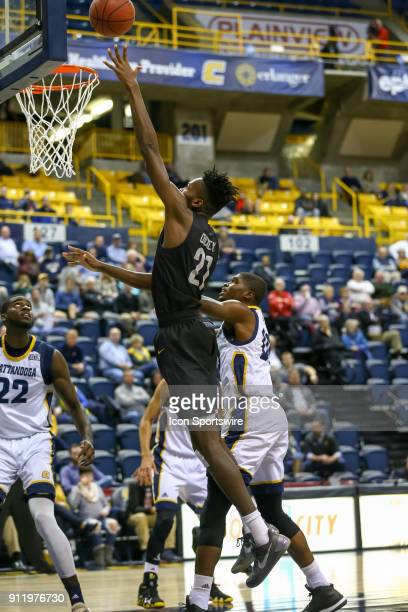Greensboro Spartans forward James Dickey scores with an easy lay up during the college basketball game between UTChattanooga and UNC Greensboro on...
