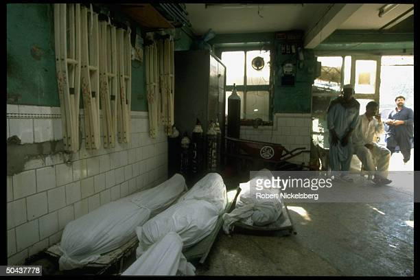 Unclaimed bodies of destitute poor beggars /or drug addicts found dead on street in white shrouds awaiting burial by charitable Edhi Foundation