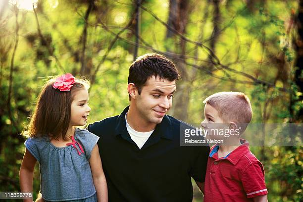 uncle and his niece and nephew - uncle stock photos and pictures