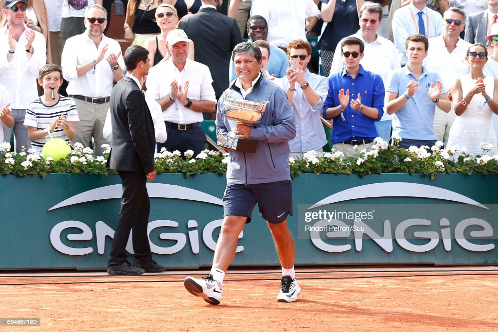 Uncle and Trainer of Rafael nadal, Toni Nadal brings the Cup to Rafael Nadal after his victory during the Men Final of the 2017 French Tennis Open - Day Fithteen at Roland Garros on June 11, 2017 in Paris, France.