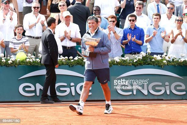 Uncle and Trainer of Rafael nadal Toni Nadal brings the Cup to Rafael Nadal after his victory during the Men Final of the 2017 French Tennis Open Day...