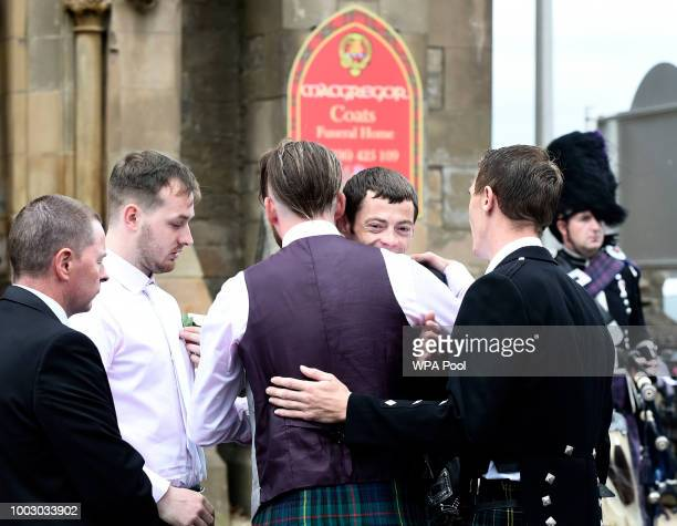 Uncle Calum MacPhail receives a hug at the funeral of sixyearold Alesha MacPhail at the Coats Funeral Home on July 21 2018 in Coatbridge Scotland...