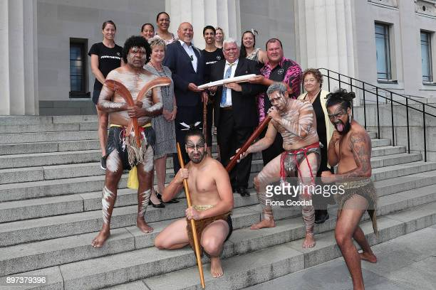 Uncle John Graham of the Yugambeh clan holds the Queens Baton with Taiaha Hawke of Ngati Whatua at Auckland War Memorial Museum during the...