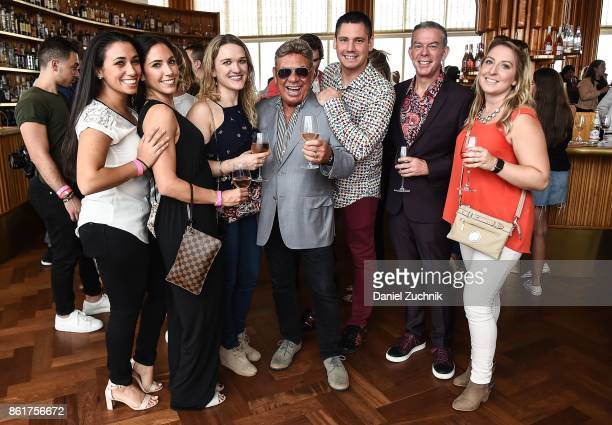 Uncle Johnny and Elvis Duran pose with guests during the Food Network Cooking Channel New York City Wine Food Festival Presented By CocaCola Rooftop...