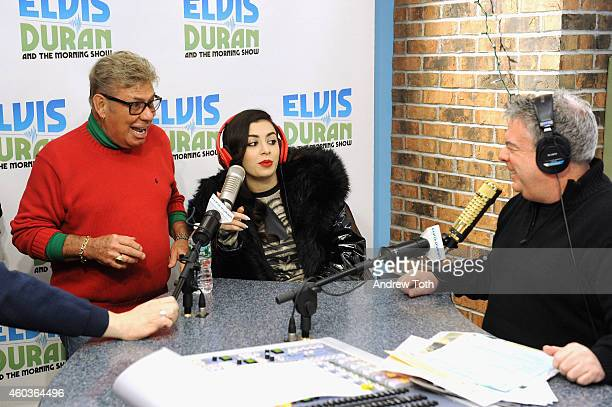 Uncle Johnny Charli XCX and Elvis Duran visit The Elvis Duran Z100 Morning Show at Z100 Studio on December 12 2014 in New York City