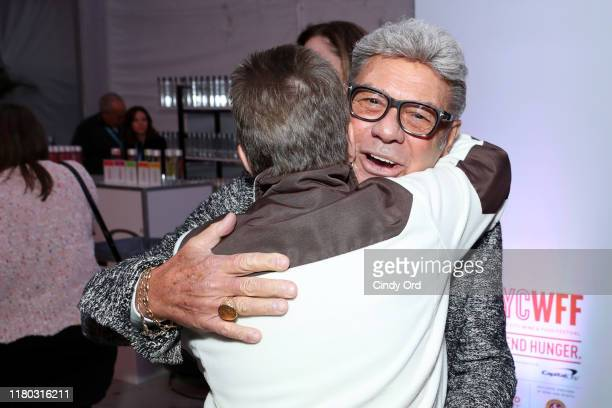 Uncle Johnny from Z100 greets a guest during Elvis Duran's Taste of New York presented by Intrinsic Wines hosted by Elvis Duran and the Z100 Morning...
