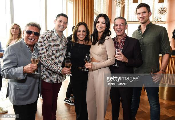 Uncle Johnny Katie Lee and Elvis Duran pose with guests during the Food Network Cooking Channel New York City Wine Food Festival Presented By...