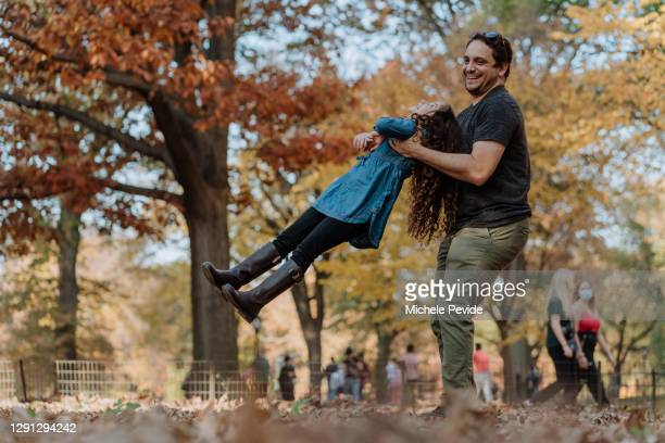 uncle playing with niece in the park - niece stock pictures, royalty-free photos & images
