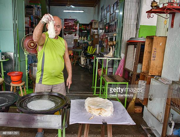Uncle Popiah, longtime famous popiah dough maker in Georgetown in Penang, Malaysia