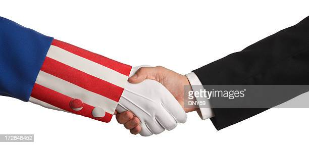 Uncle Sam and a businessman shaking hands on white background
