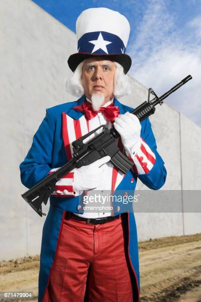 Uncle Sam guarding the border wall with a rifle