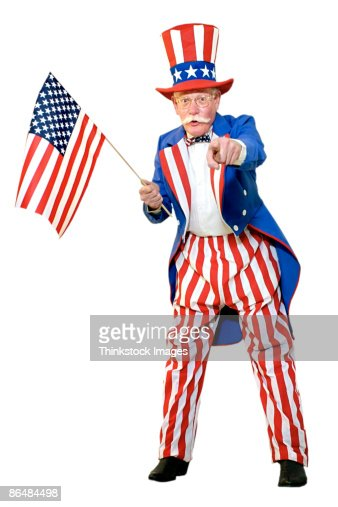 uncle sam holding american flag and pointing stock photo getty images. Black Bedroom Furniture Sets. Home Design Ideas