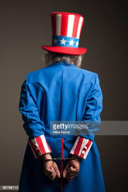 uncle sam in handcuffs - uncle stock photos and pictures